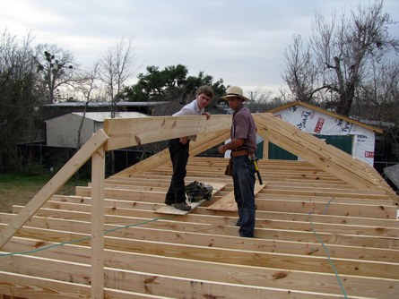Volunteers from Christian Aid Ministries working on the roof.
