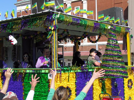 A festive float in Mardi Gras colors.