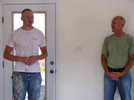 Jeremy Snow (left) of Hope Force speaks while Craig Snow looks on.