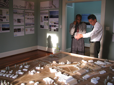 Mayor Xavier Bishop (l) and GCCDS Director David Perkes discuss the model of downtown Moss Point.