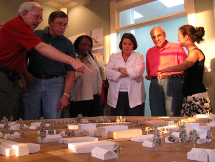 GCCDS member Nadene Mairesse (r) and community members discuss the model of downtown Moss Point.